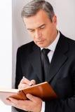 Fazendo anotações urgentes Foto de Stock