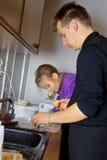 Fazendo bolinhos Foto de Stock Royalty Free