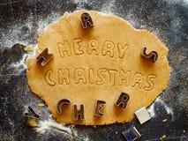Fazendo a cookie exprime o Feliz Natal Imagem de Stock