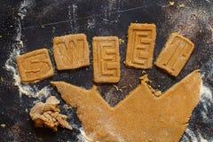 Fazendo letras da cookie Fotos de Stock Royalty Free