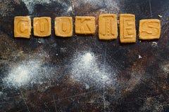 Fazendo letras da cookie Imagens de Stock