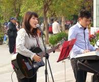 Fazendo a música no parque Fotografia de Stock