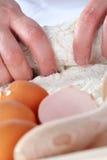Fazendo a massa de pão Imagem de Stock