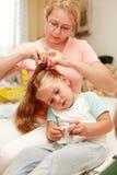 Fazendo o cabelo Imagem de Stock