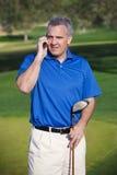 Fazendo o negócio no campo de golfe Fotografia de Stock