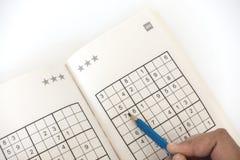Fazendo o sudoku Imagem de Stock Royalty Free