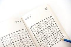 Fazendo o sudoku Imagens de Stock