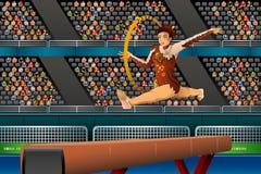 Fazer da menina ginástico com a aro na competição Imagens de Stock