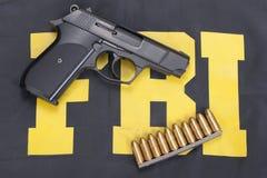 Fbi concept. Hand gun and ammo Royalty Free Stock Photos