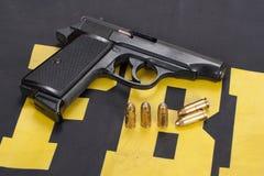 Fbi concept. Hand gun on FBI uniform Royalty Free Stock Images