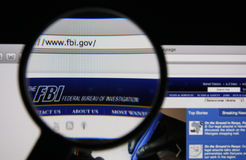 FBI. Photo of FBI homepage on a monitor screen through a magnifying glass Stock Photos