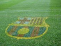 fc-barcelona-emblem-on-stadium-turf Royalty Free Stock Photo