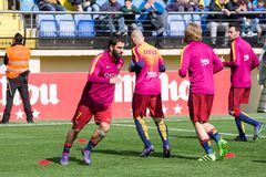 FC Barcelona football players warm up prior to the La Liga match between Villarreal CF and FC Barcelona Stock Image
