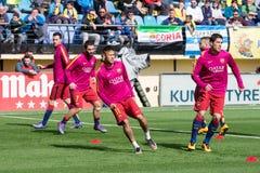 FC Barcelona football players warm up prior to the La Liga match between Villarreal CF and FC Barcelona Stock Photo