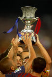 FC Barcelona players hold up Supercup trophy. After the Spanish Supercup football match at the New Camp Stadium in Barcelona, on August 17, 2011 Stock Photography