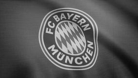FC Bayern Munich flag is waving, monochrome, tv noise. Close-up of waving flag with FC Bayern Munich football club logo. FC Bayern Munich flag is waving on stock video footage