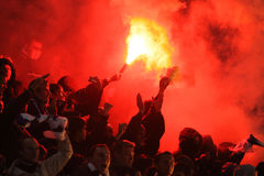 FC Dynamo Kyiv ultra supporters burn flares Stock Photo