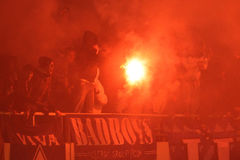 FC Dynamo Kyiv ultra supporters burn flares Royalty Free Stock Photo