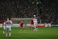 1FC Kaiserslautern and 1FC Koln. Defender FLORIAN DICK (23) and Midfielder YANNICK GERHARDT (31) header the ball. The 1FC Kaiserslautern hosted the 1FC Koln at Stock Photography