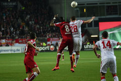 1FC Kaiserslautern and 1FC Koln. Forward MOHAMADOU IDRISSOU (8) and Defender KEVIN WIMMER (28) leap after the ball. The 1FC Kaiserslautern hosted the 1FC Koln at Stock Photography