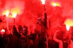 FC Metalist Kharkiv fans. KHARKIV, UKRAINE - OCTOBER 7: FC Metalist Kharkiv fans burns fire during football match vs FC Shakhtar Donetsk, October 7, 2012 in Stock Image