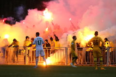 FC Metalist Kharkiv ultras supporting their team with a pyro-show Royalty Free Stock Photos