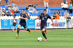 FC Metallurg players running on the field Royalty Free Stock Image
