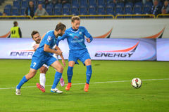 FC Olimpik player in a penalty area Royalty Free Stock Photos