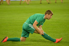fc vorskla player is doing stretching photo was taken during the match between dnipro dnipropetrovsk city and poltava city at Royalty Free Stock Images