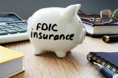 FDIC insurance policy on a desk. FDIC insurance policy on an office desk Royalty Free Stock Photos