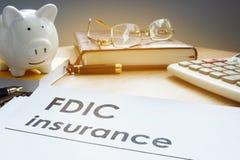 FDIC insurance on a side of piggy bank. FDIC insurance on the side of piggy bank Stock Photo