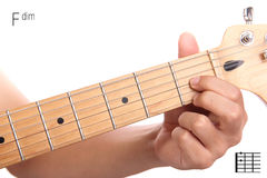 Fdim guitar chord tutorial. Fdim - advanced guitar keys series. Closeup of hand playing F diminished chord, isolated on white background Royalty Free Stock Photos