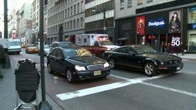 FDNY ambulance speeding through busy Manhattan stock video
