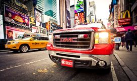 FDNY car and taxi car on Times Square Stock Photo