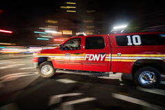 FDNY Emergency Pick-up Truck Passing Fast at Night in Manhattan, Stock Image