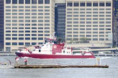 FDNY Fire Boat. Fire Department of New York fire boat in the East River between Brooklyn and Manhattan in New York City Royalty Free Stock Photos