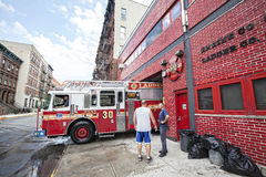 FDNY fire truck backs into garage. New York City, USA - August 16, 2015: FDNY fire truck backs into garage. Ladder 30 shares a house with Engine 59 in Harlem royalty free stock photos