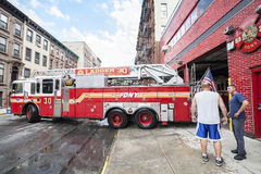 FDNY fire truck backs into garage. Stock Image