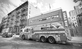 FDNY fire truck parked in front of engine house. Stock Image
