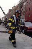 FDNY firefighter carrying tools and equipment in New York City, USA Royalty Free Stock Photo