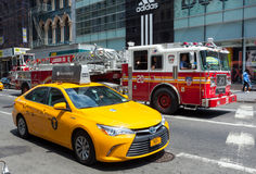 FDNY firetruck and yellow cab in Manhattan Royalty Free Stock Photography