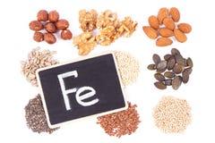 FE de la inscripción con los ingredientes sanos como el hierro de la fuente, los ácidos de Omega, las vitaminas, los minerales y  imagenes de archivo
