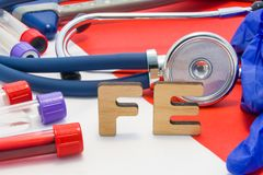 FE medical abbreviation meaning total iron or ferrum in blood in laboratory diagnostics on red background. Chemical name of FE is. Surrounded by medical stock image