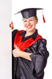 Feale graduate displaying a banner Stock Photo