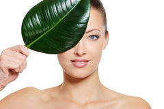 Feamle face covering with a green leaf Stock Photo