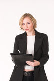 Feamle inspector #12. Female business woman with blue eyes and ledger making notes Stock Photo