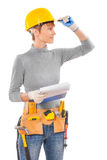 Feamle wearing working clothes with construction tools holding b Stock Photo