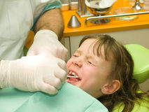 Fear. Little girl having fear of dental care royalty free stock image
