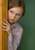 Fear. A girl looking out of the corner in horror Stock Images