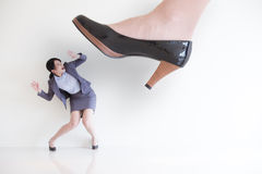 Fear business woman. Business woman steping on a fear woman, business concept , asian model royalty free stock photo
